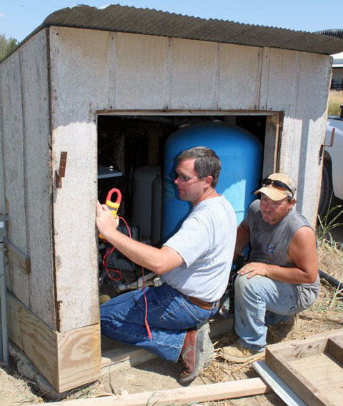 Being a farmer means doing a little bit of everything. Michael Springer (left), helps with this on-farm project.