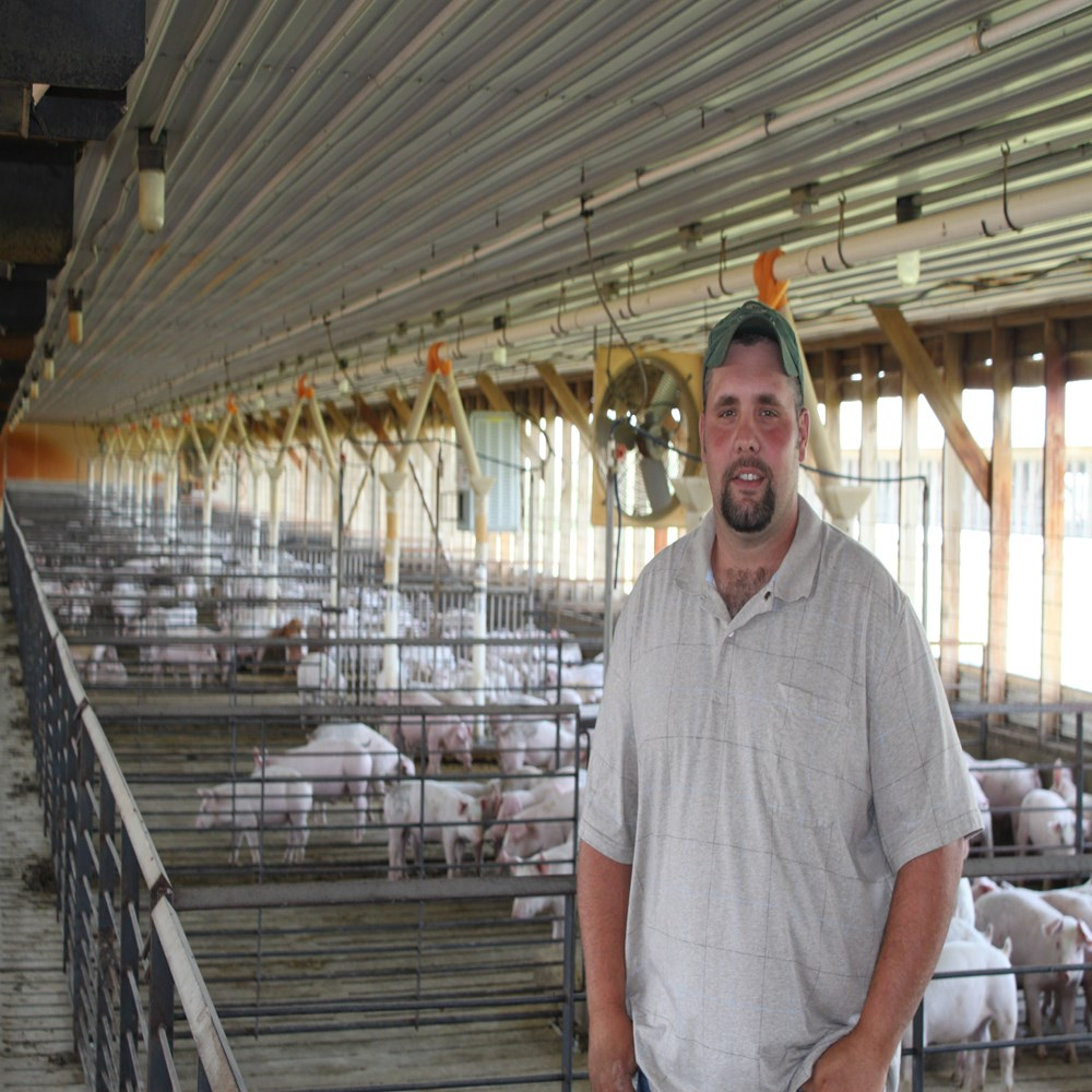 Josh, Jerry's son, stops for a quick picture in the pig barn.